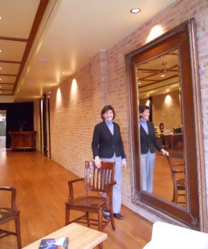 Zina Murray Stands Near The Front Windows Of Logan Square Kitchen With Area In Background Before Leed Certification